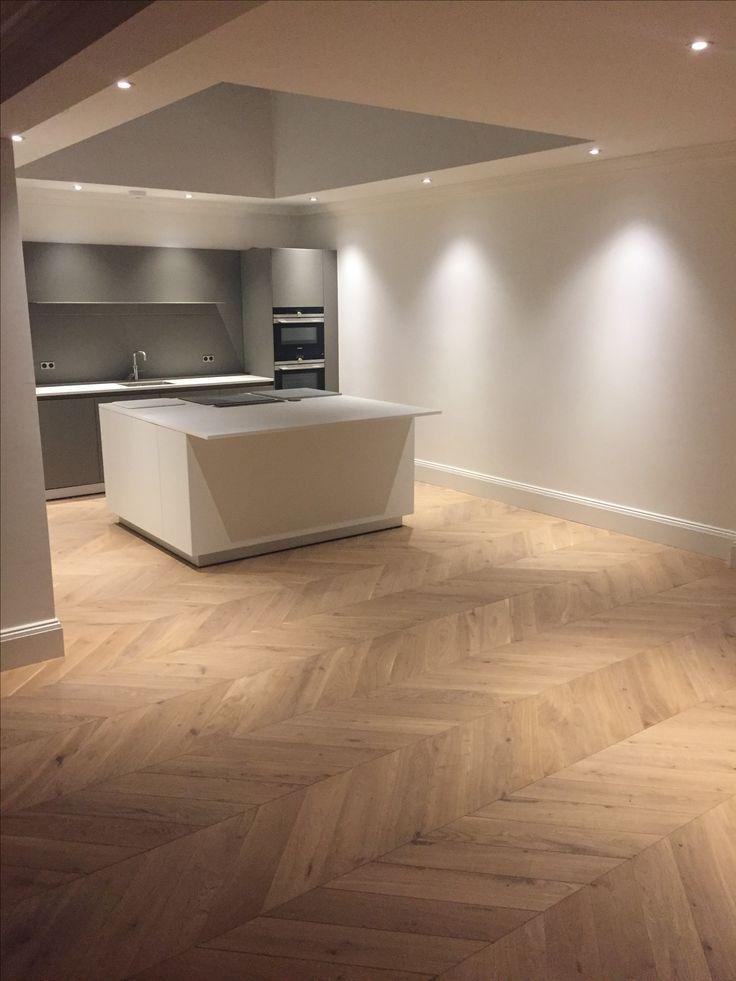 Chevron engineered oak parquet hardwood flooring in the