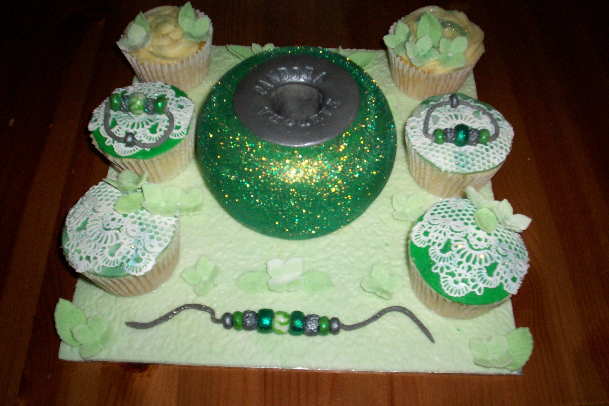 Have a look at this bracelet themed cake by Sandy Pledger! How unusual.