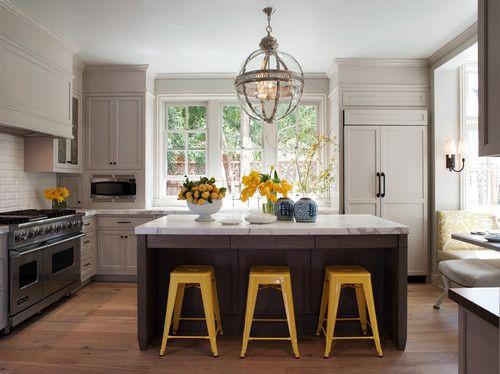 dark + light cabinets, yellow stools