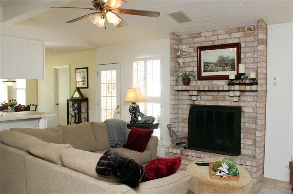 windows flanking fireplace with sectional | living rooms ...