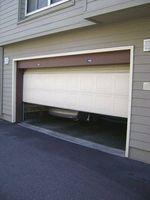 How To Fix A Sagging Garage Door Garage Door Springs Garage Doors Residential Garage Doors