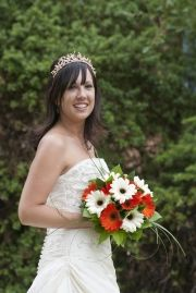 Bride with orange flowers in the garden