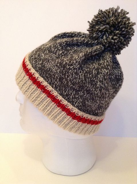 This is a classic tuque with the wool sock design worked into it. The look  is very popular and adults 07b6137837c5