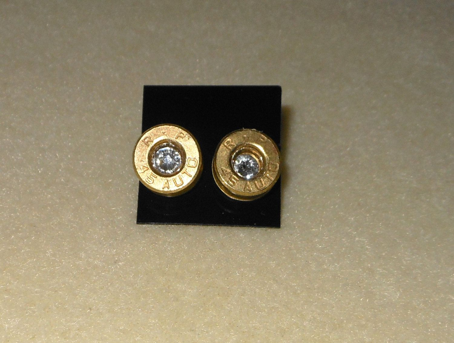 Bullet Shell casing Earrings/Remington Peters 45 Automatic shells/pierced earrings/bullet 45 earrings with crystals clear by CreationsbyMaryEllen on Etsy