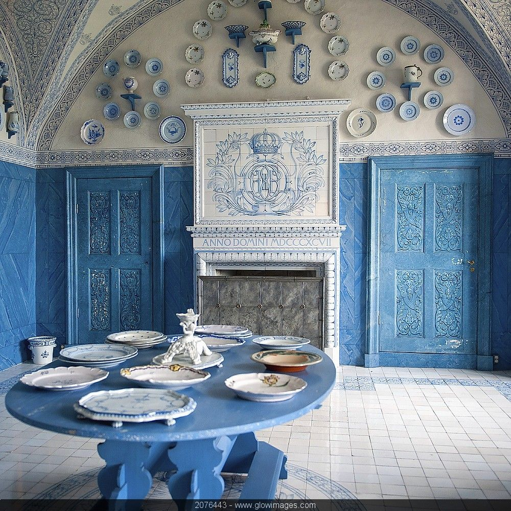 Plates on display in a blue and white room in Drottningholm palace, Stockholm, Sweden. Destinations #2076443.
