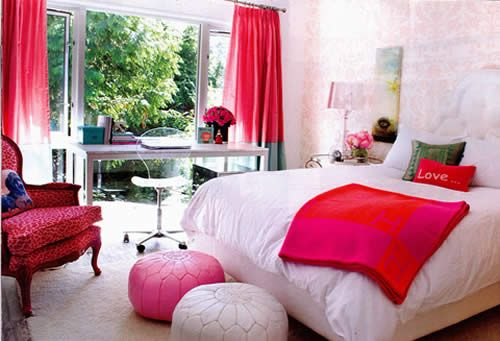 I like red color in this bed room. red colour is used as an accent. red with grey creating interest.square cushion, round floor cushions rectangle shape of bed and dresser is creating interest. white colour is making room big.