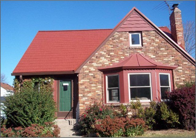 Here S A Unique Red Metalroof On This Brick Mn Home Not Only Does The Upper Roof Get Your Attention In A C Roof Architecture Architecture Details Metal Roof