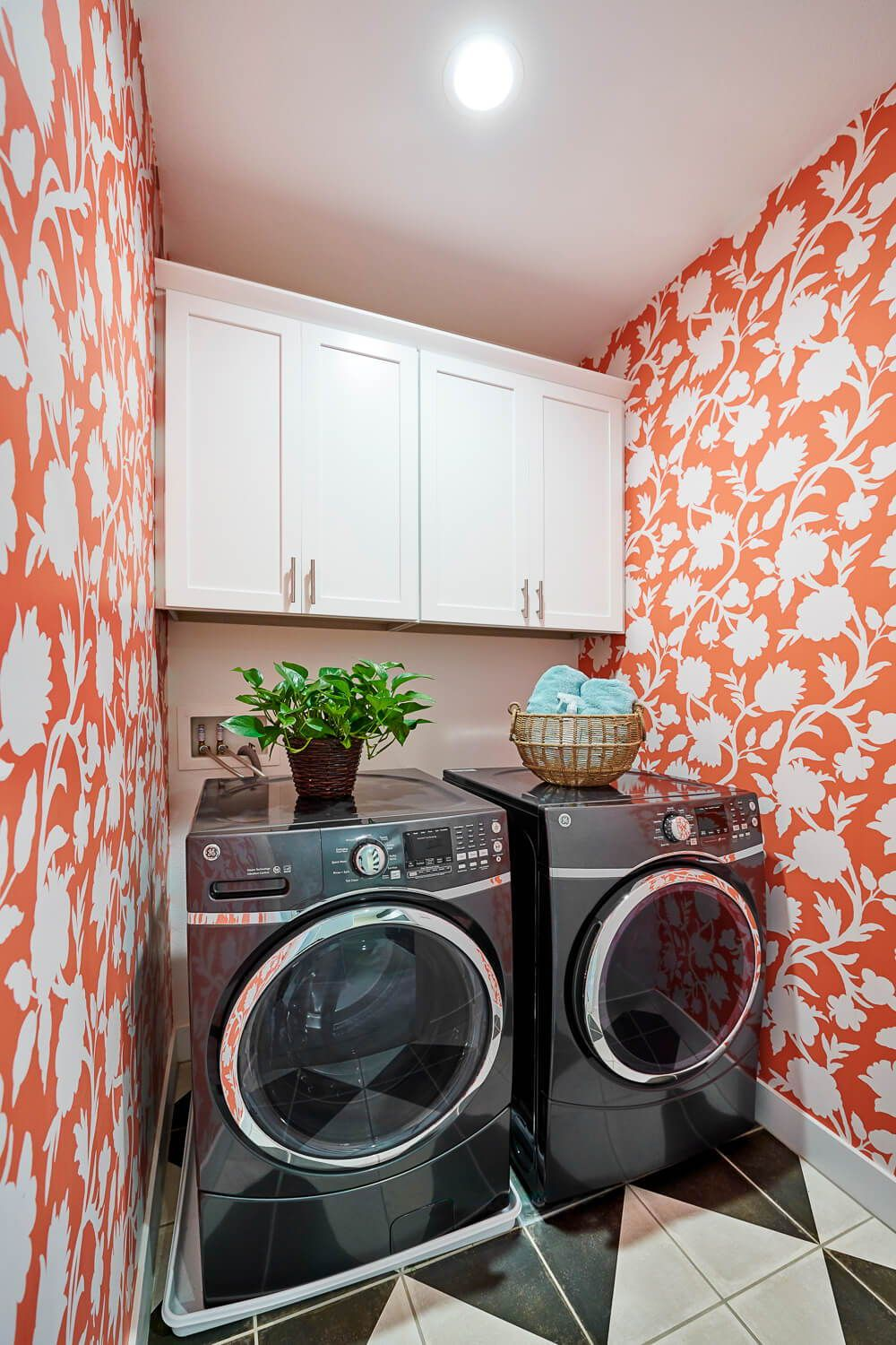 A bright orange and white wallpaper makes doing laundry ...