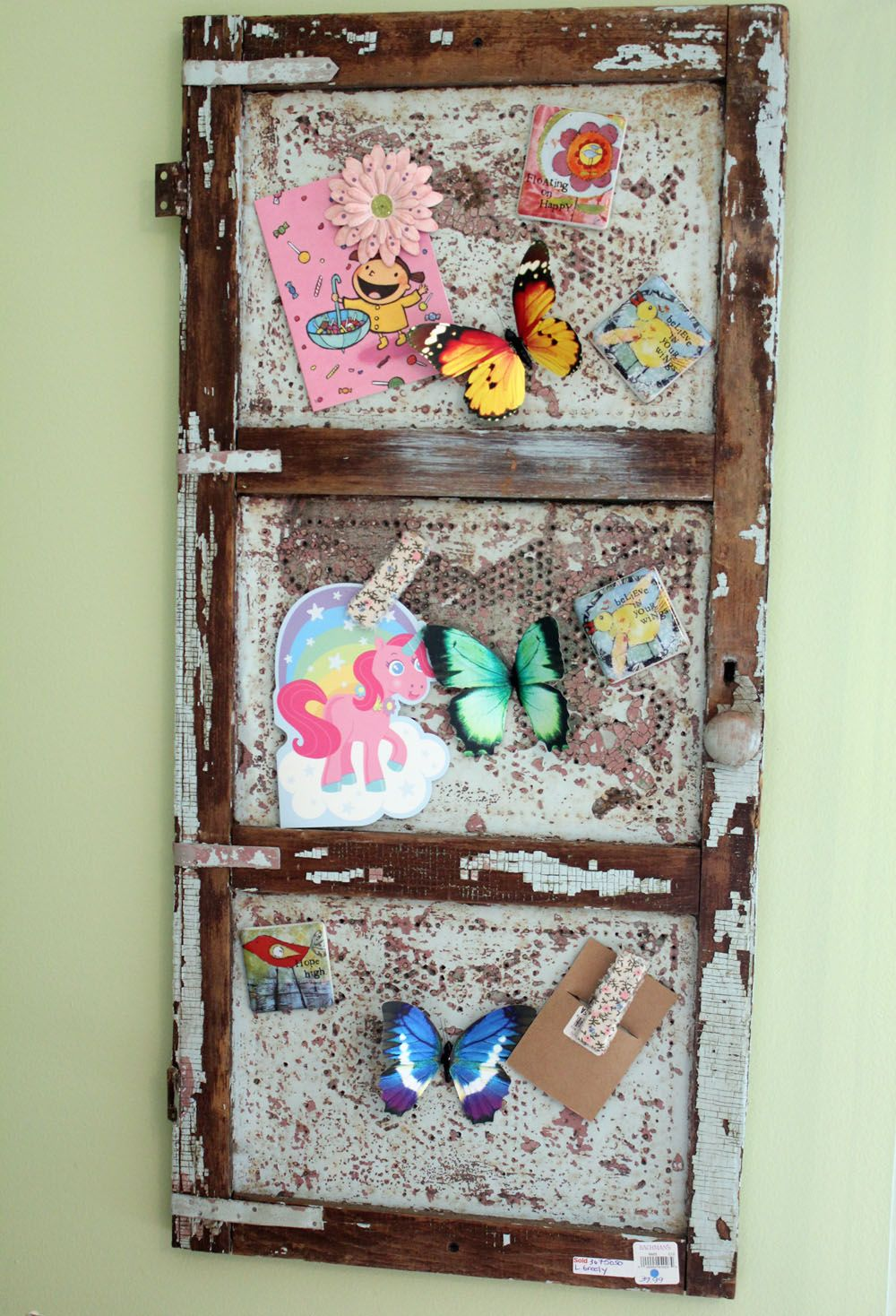 An old pie safe door becomes a magnet board windows shutters