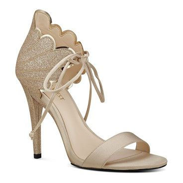 b0c8cf9ed  carly  ankle tie sandal by Nine West. A wing-like counter characterized