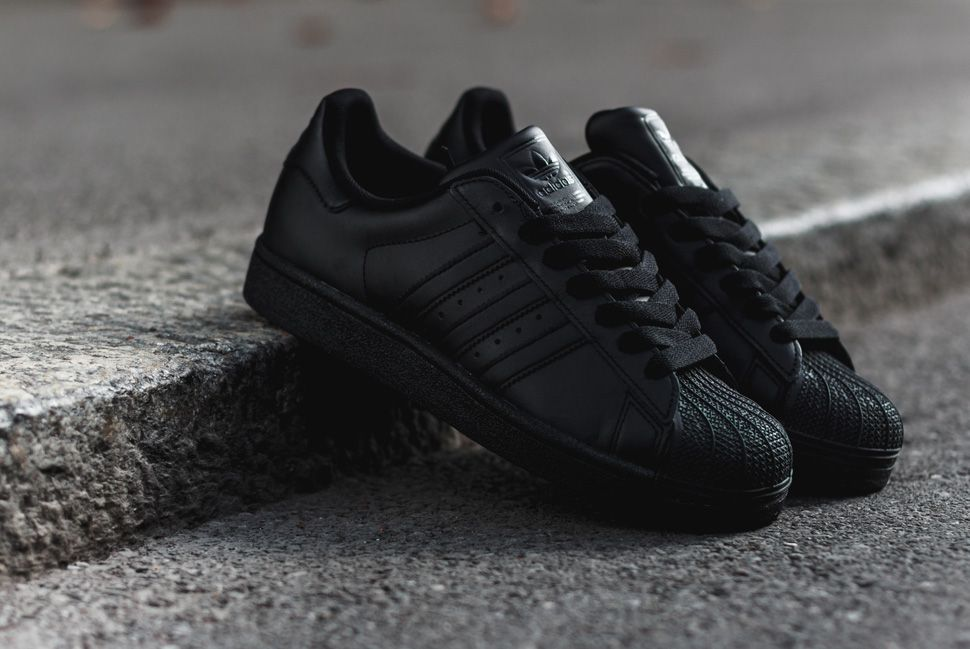 a3598bbed The cross brand focus on triple black footwear this season includes the  adidas Superstar. Leather built
