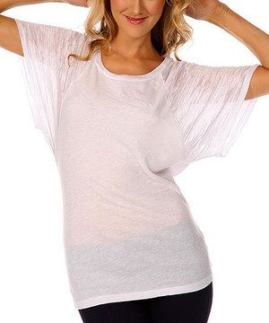 Every wardrobe needs a sweet collection of staples to savor. Featuring a figure-skimming silhouette and supple fabric, this burnout sleeve top is guaranteed to lend comfort and style.