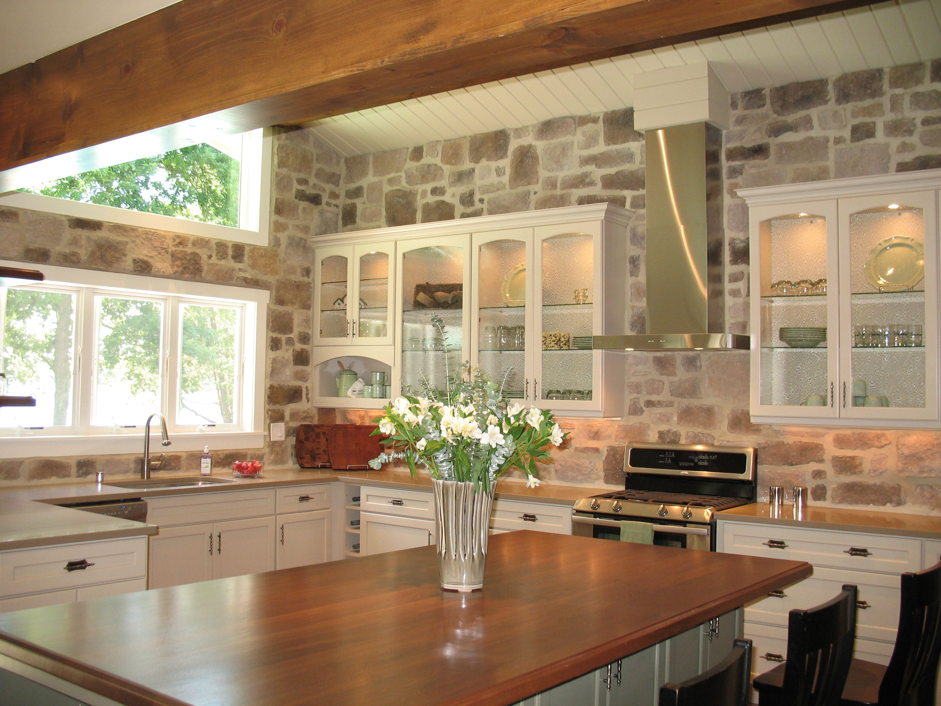 Traditional Kitchen With Stone Wall And Wood Beams Kitchen Remodel Cost Kitchen Remodel Stone Kitchen