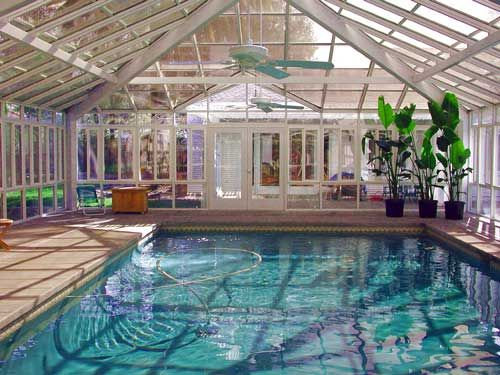 I Love The Greenhouse Feel Of This Room The Ceiling Fans Are A Great Touch Luxury Swimming Pools Indoor Pool Pool Houses