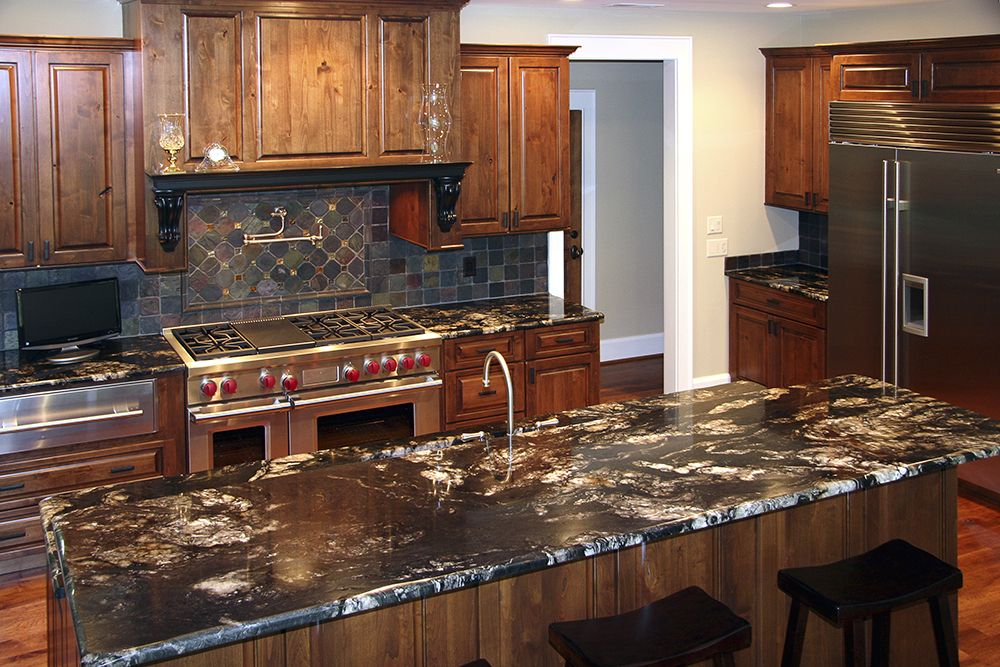 The Stone In This Kitchen Is Black Titanium From Brazil With A Rustic Edge Detail Stone Connection In Henderso Titanium Granite Home Fireplace Kitchen Remodel