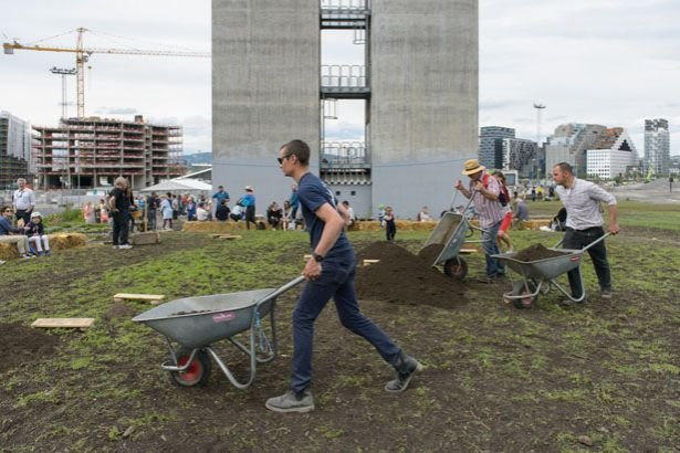 flatbread society. On June 13, 2015 a procession of farmers carried soil from their farms through the city of Oslo to its new home at Losæter.