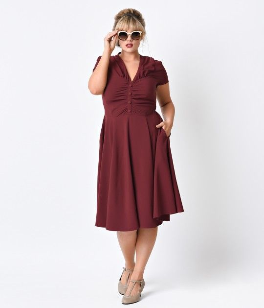 A timeless design that will never grow old! Rosina is a frock fresh Hell Bunny in a rapturously radiant burgundy crepe, cast in a plus size retro dress style that will become an immediate midcentury favorite. Woven while remaining lightweight and infused