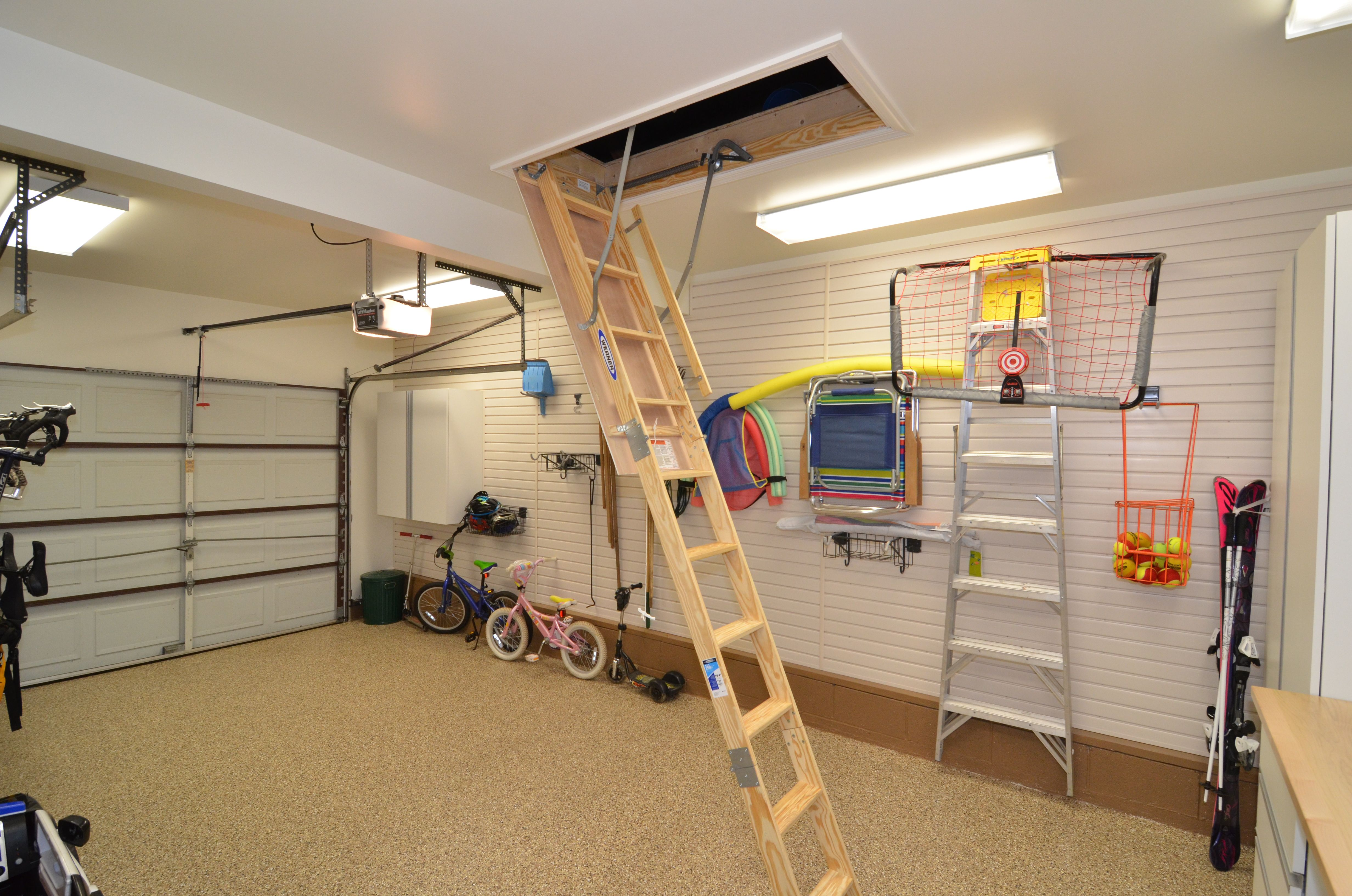 After Finished Attic Space Above Garage And Pull Down Stairs For Easy Access Attic Spaces Finished Attic House Design