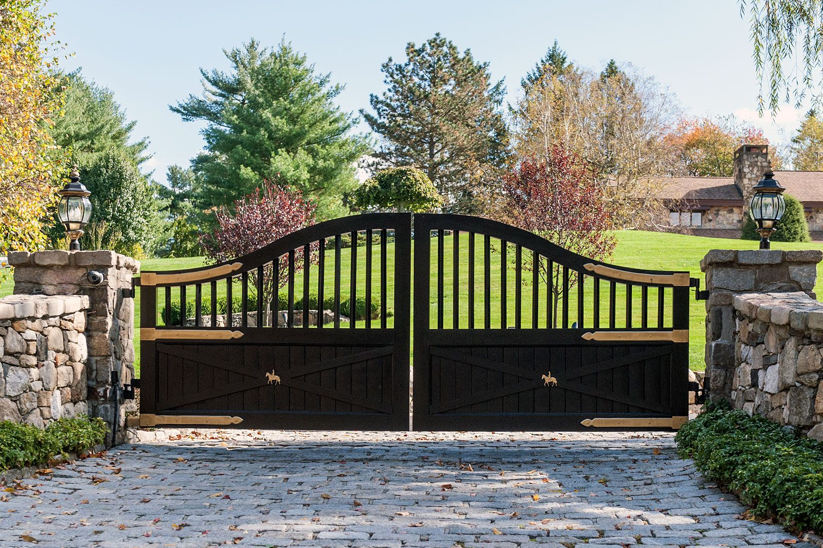 Black Classic Ranch Or Farmhouse Automated Driveway Gate With Unique Gold Painted Iron Horse Details D Driveway Gate Village House Design Wood Gates Driveway