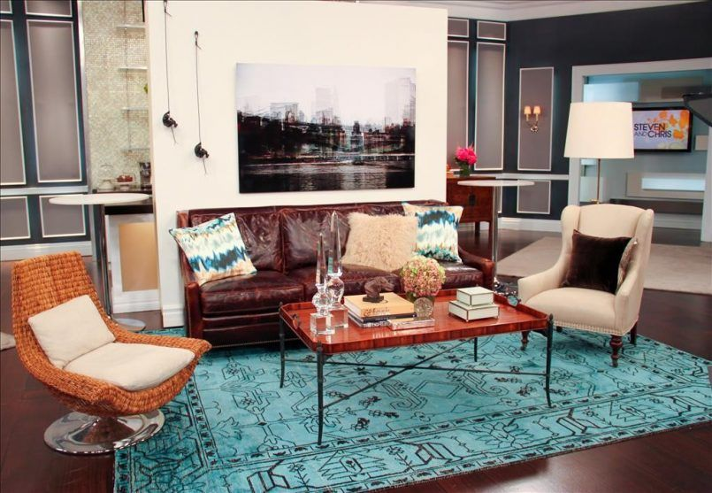 living room blue pattern carpet orange accent chair brown sofa coffee table painting window white wall