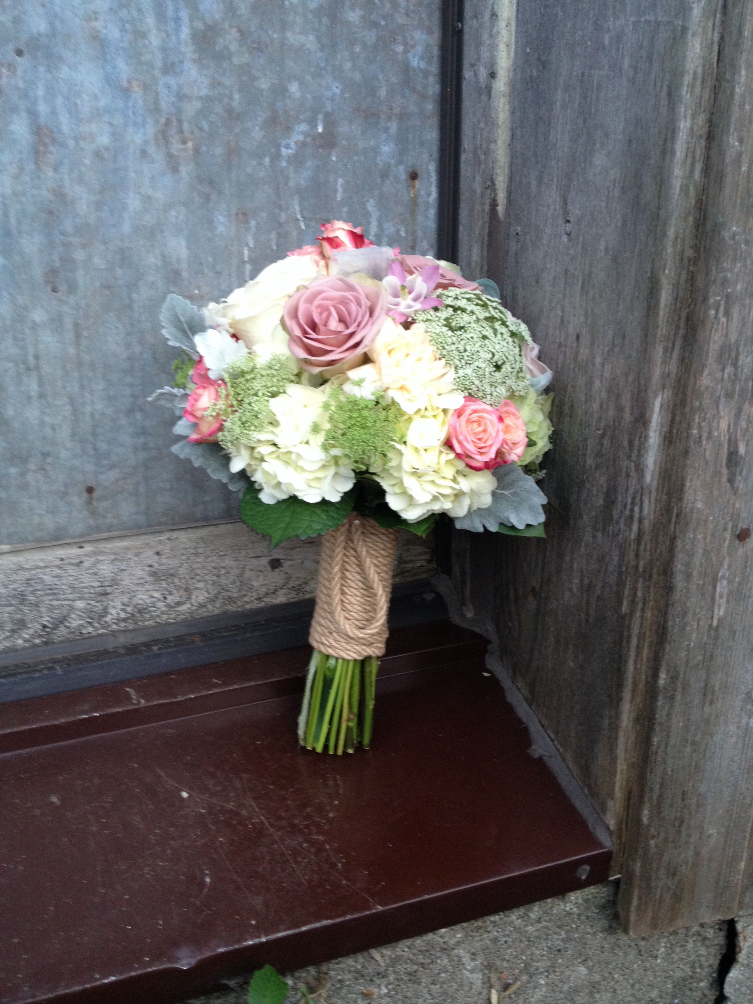 Vintage pastel wedding bouquet with rope accent. Made by Magnolia Flowers