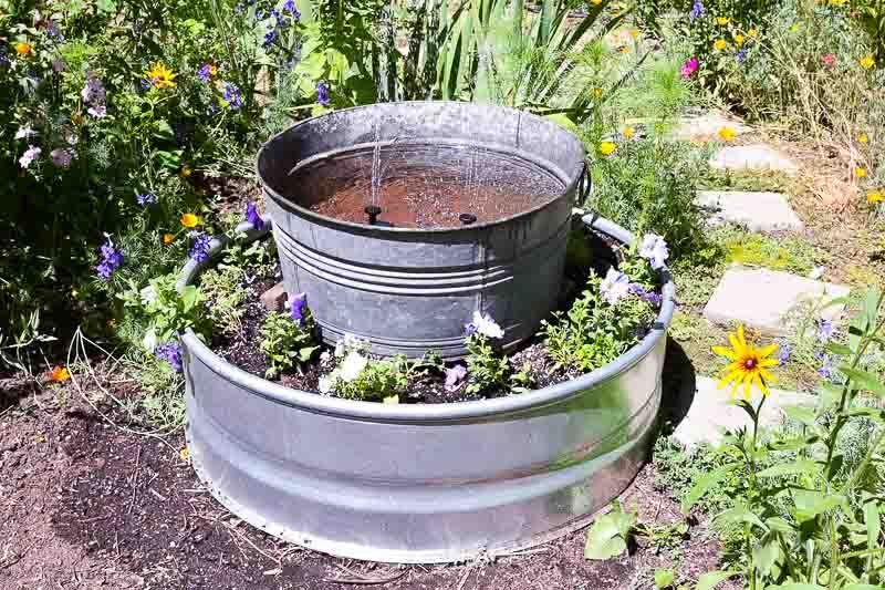 Turn A Simple Fire Ring Into A Beautiful Garden Water Feature In An Hour Easy To Do And Y In 2020 Water Features In The Garden Solar Water Fountain Diy Solar Fountain