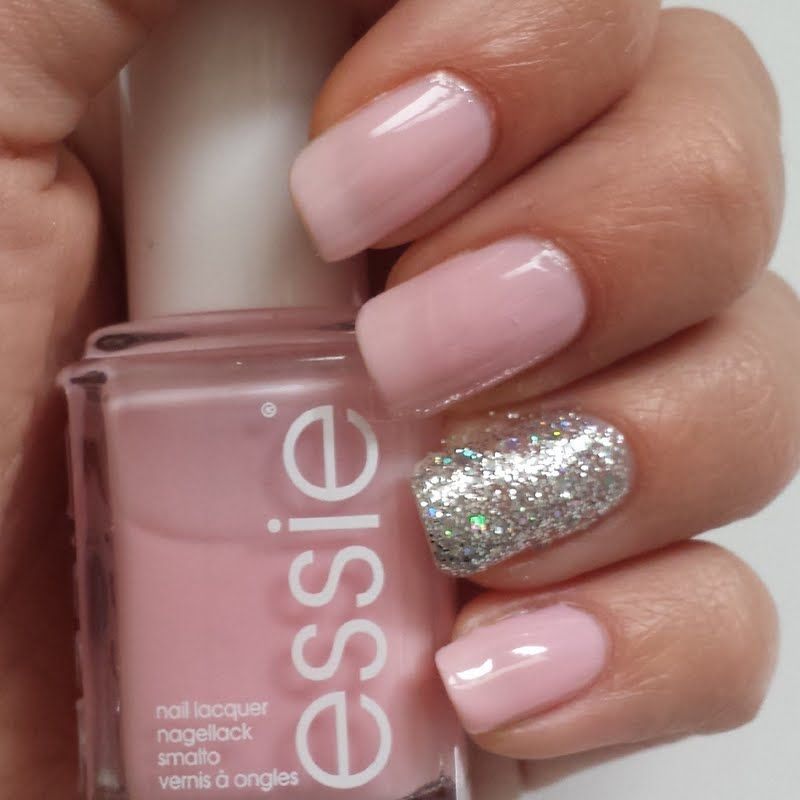 This manicure features light pink and glittered silver nail polish ...