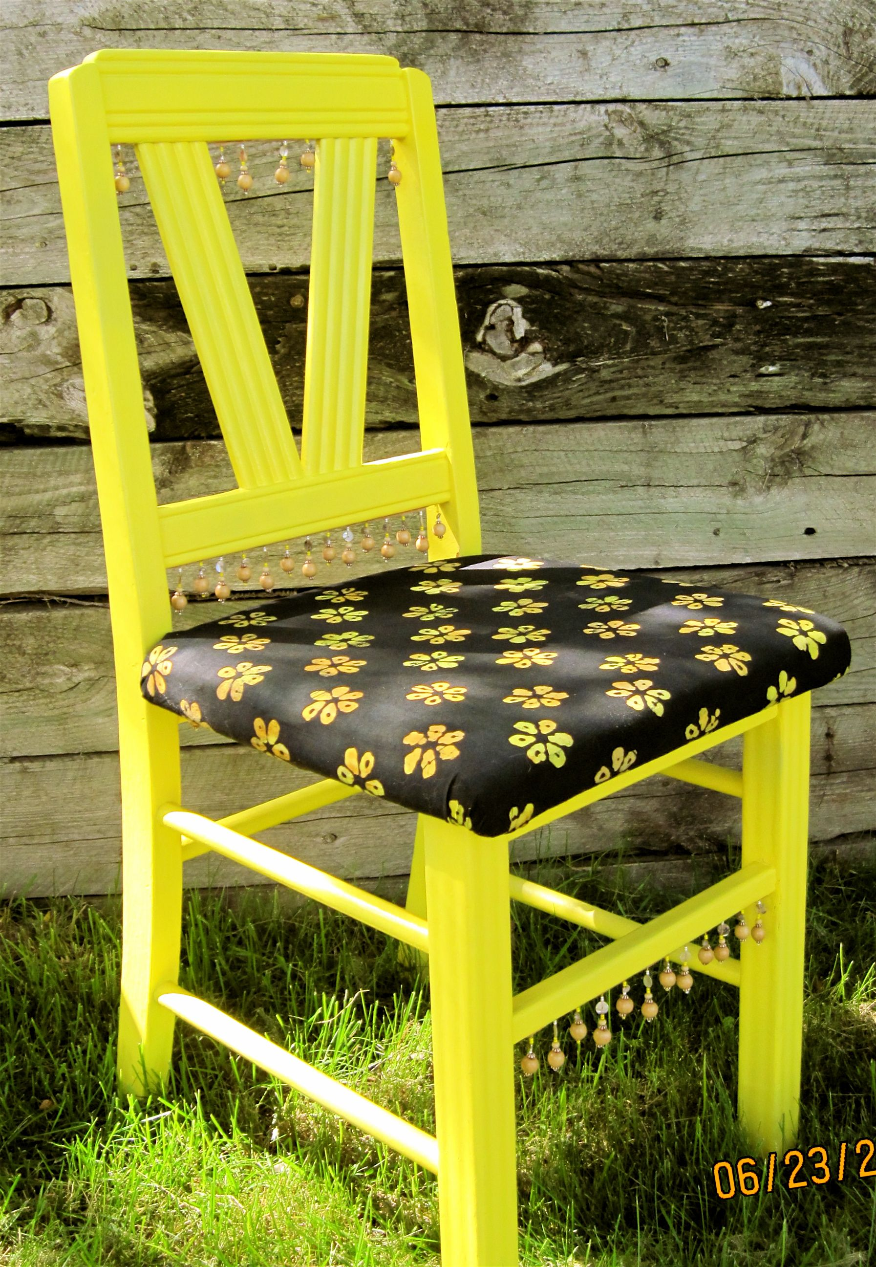Yellow kitchen chair with batik fabric and woodshell bead trim