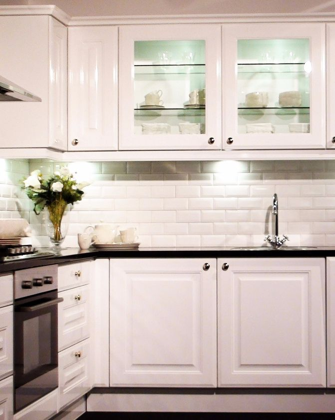 Replacing kitchen cabinets can be messy and expensive Refinishing