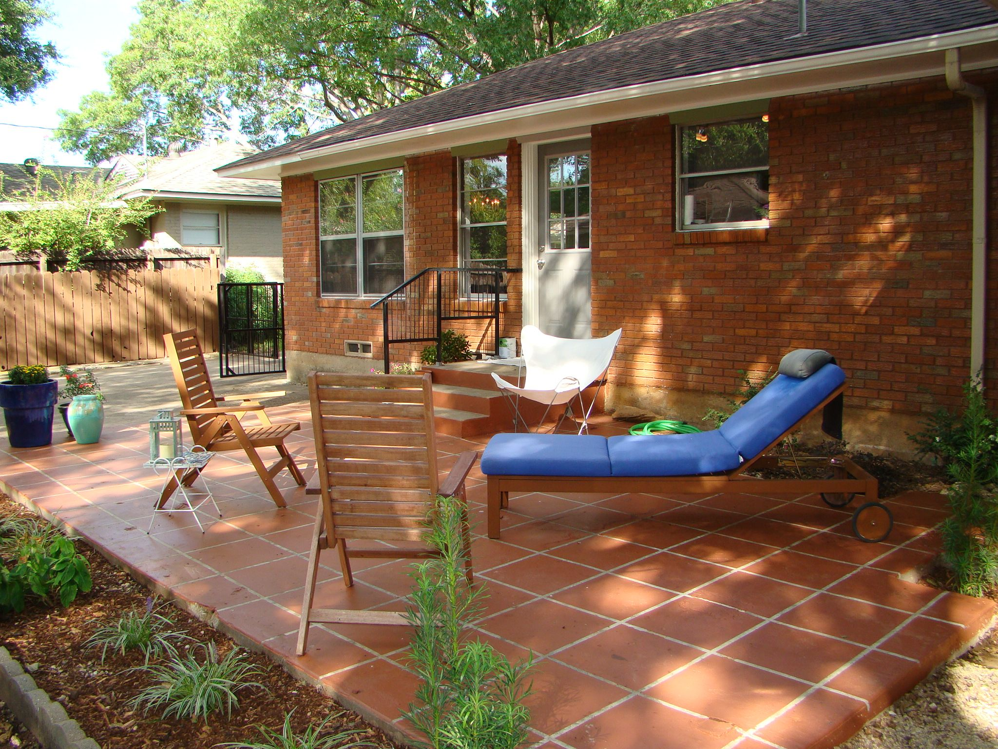 an old sunroom addition was removed leaving a large slab, painted to appear as terra cotta tiles