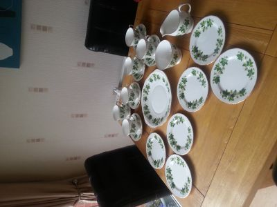 Queen Anne bone china tea set with gold (£15 to £30) - A lovely 21 piece teaset by Queen Anne, pattern number B679 grapevine. Comprising 6 cups, 6 saucers, 6 sideplates, 1 creamer, 1 sugar bowl and 1 handled cake plate.