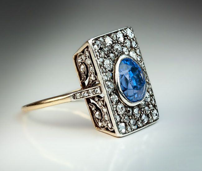 17c781d49 An Unusual Antique Sapphire and Diamond Engagement Ring circa 1900 The  rectangular silver topped 18K gold ring is centered with an egg-shaped  faceted natur