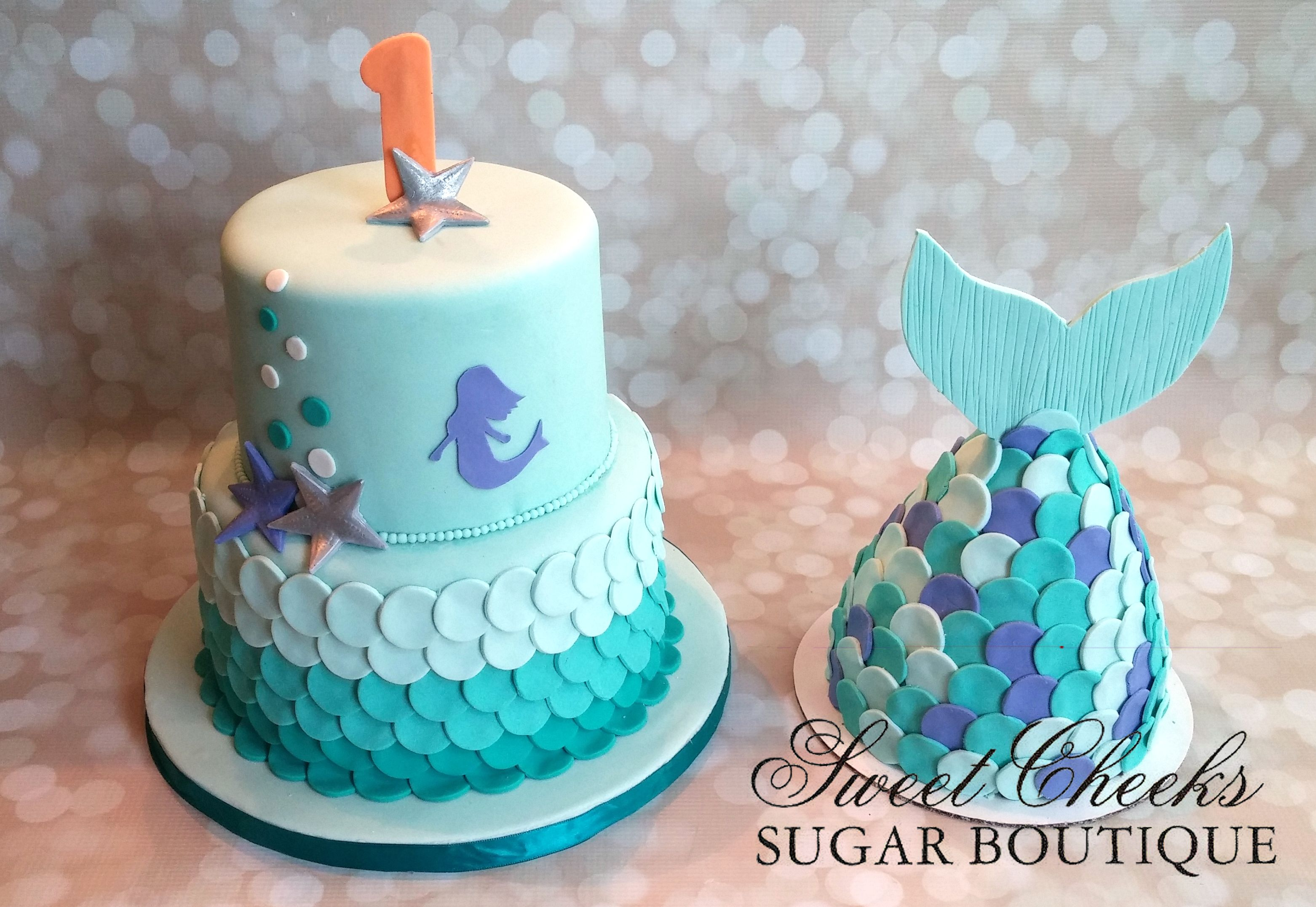 A mermaid themed first birthday cake and matching mermaid tail smash cake!