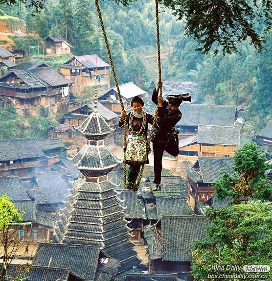 Playing on the swings - Liang Min, Guizhou province