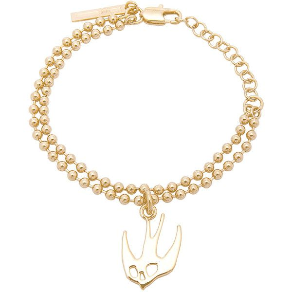 McQ Alexander McQueen Swallow Bracelet (164 AUD) ❤ liked on Polyvore featuring jewelry, bracelets, gold tone jewelry, layered jewelry, mcq by alexander mcqueen and pendant jewelry