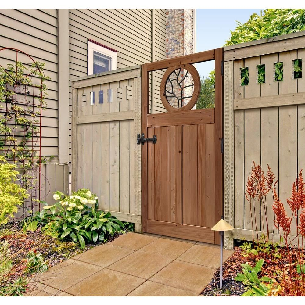 3 5 Ft X 6 Ft Cedar Fence Gate With Round Metal Art Insert 201568 The Home Depot Fence Gate Design Cedar Fence Backyard Fence Decor