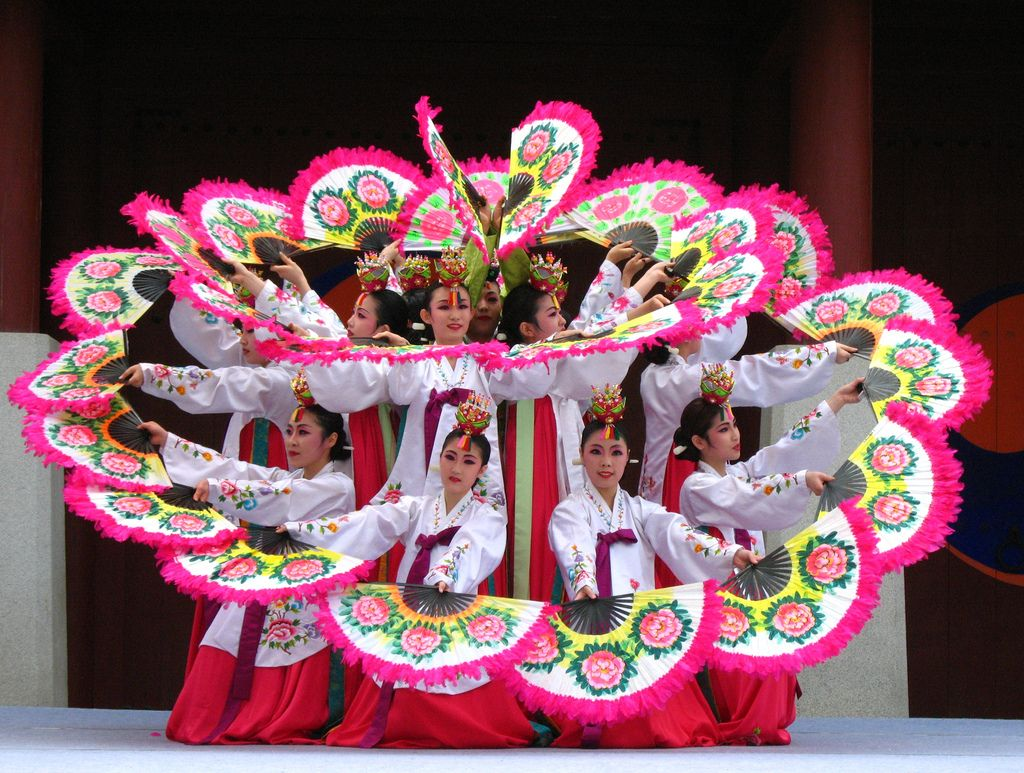 Image result for North Koreans choreographed dances,  traditional dances and gymnastics.