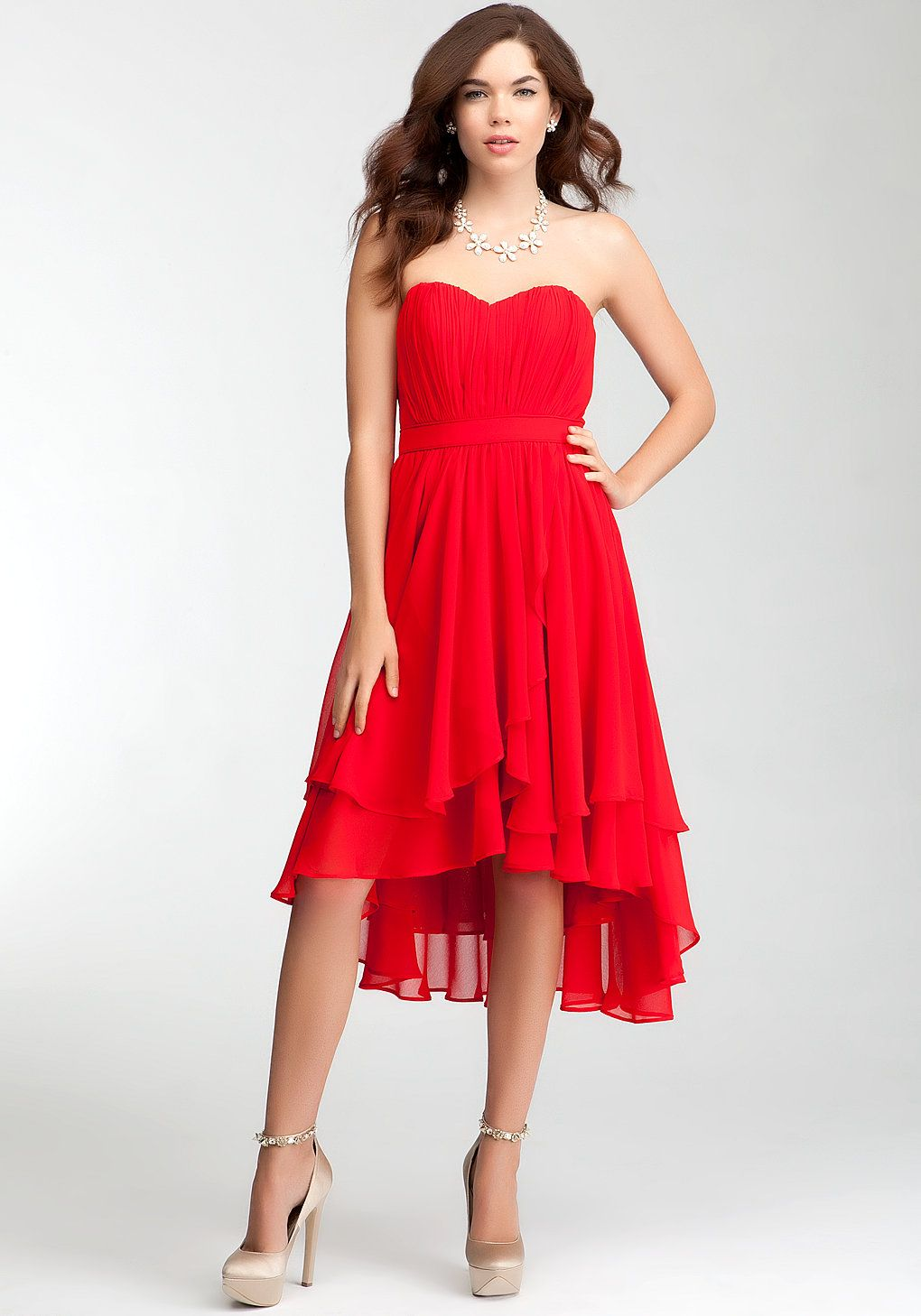 Bebe pleated strapless layer skirt dress rami kashou bridal with a strapless heart shaped neckline and asymmetric layered skirt this bebe bridesmaid dress accentuates the shoulders and shows off the ombrellifo Choice Image
