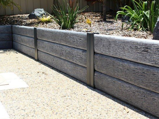 Woodgrain Look Concrete Sleepers An Easy And Affordable Way To Build A Beautiful Lo Garden Retaining Wall Landscaping Retaining Walls Backyard Retaining Walls