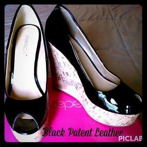 I just discovered this while shopping on Poshmark: Aislin ~ Black Patent Leather Peep Toe Wedge NWOT. Check it out!  Size: 8.5