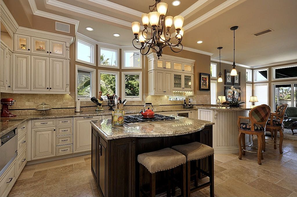 upper cabinets with lights and glass doors. bay window ...