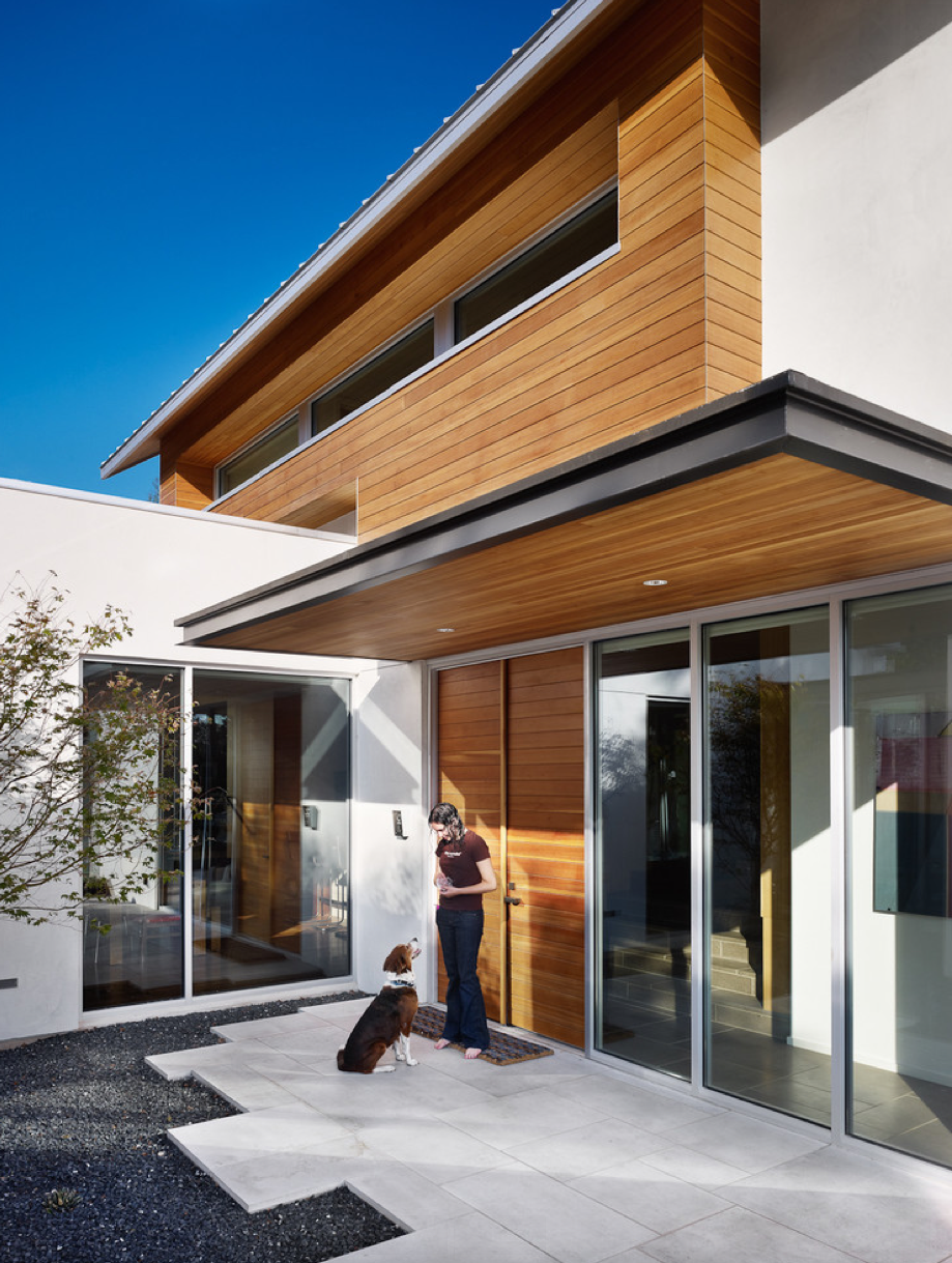 Wood panels carried through under entrance canopy need for Modern house 52