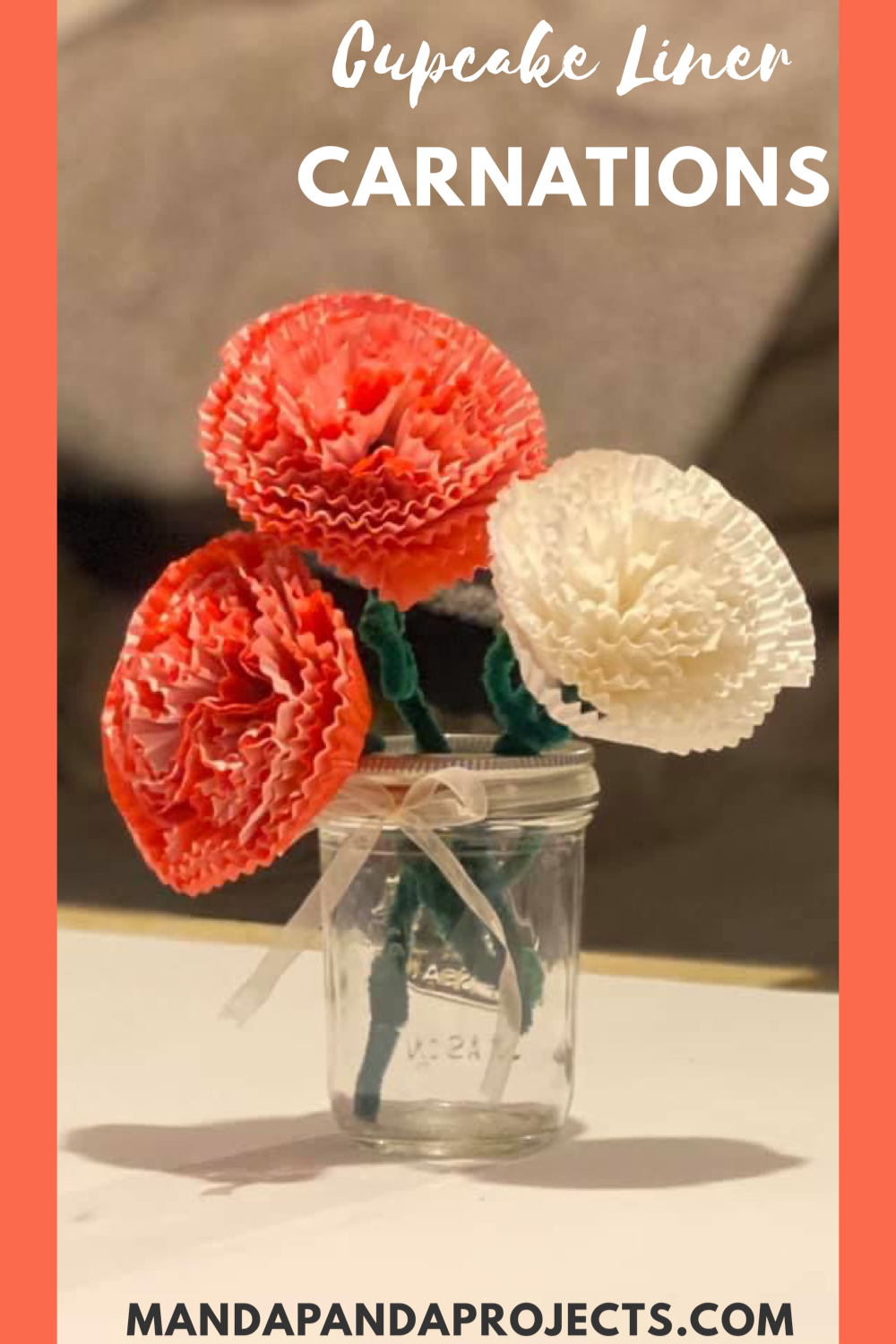 "These handmade flowers are the perfect gift for Mom this Mother's Day.  They are thoughtful, yet easy enough to make with things you already have in the house.  The best part is they will last forever.  Cupcake liner Carnations are the perfect way for the Kids to say ""I Love You"" to Mama! #mothersday #mothersdaycrafts #mothersdaycraftsforkids #mothersdaygifts #mothersdaygiftideas #mothersdaycraftiness #diymothersdaygifts #diyflowers #recycledcrafts #cupcakeliners"
