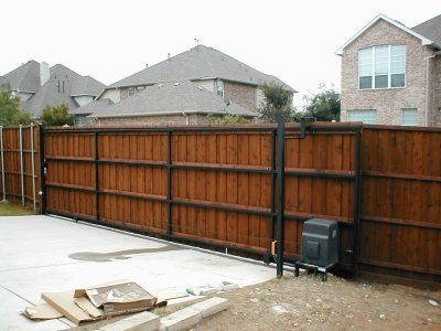 Automatic and electric gates frisco tx driveway gate for Wooden sliding driveway gates