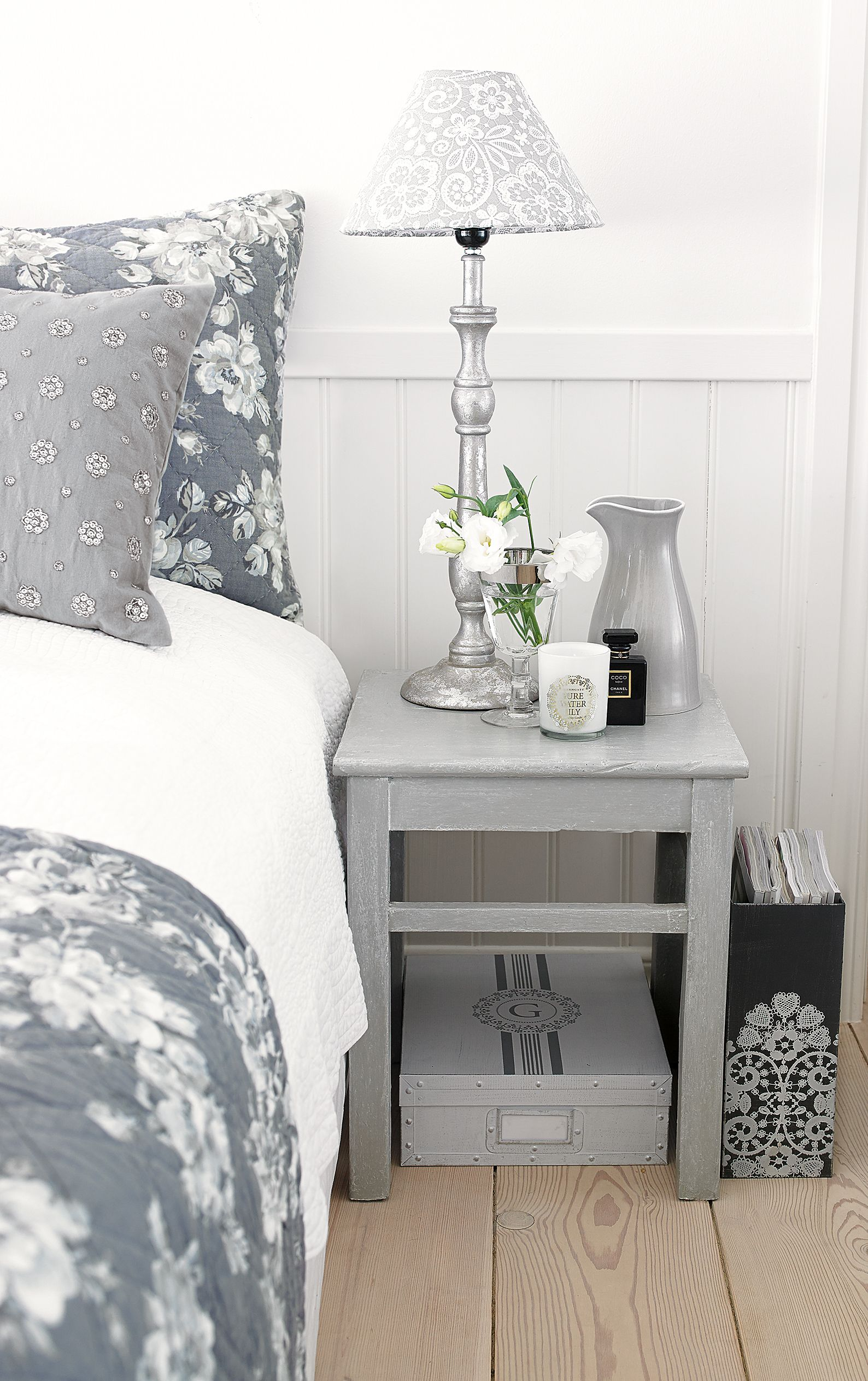 Gray and white bedroom natural wood floors