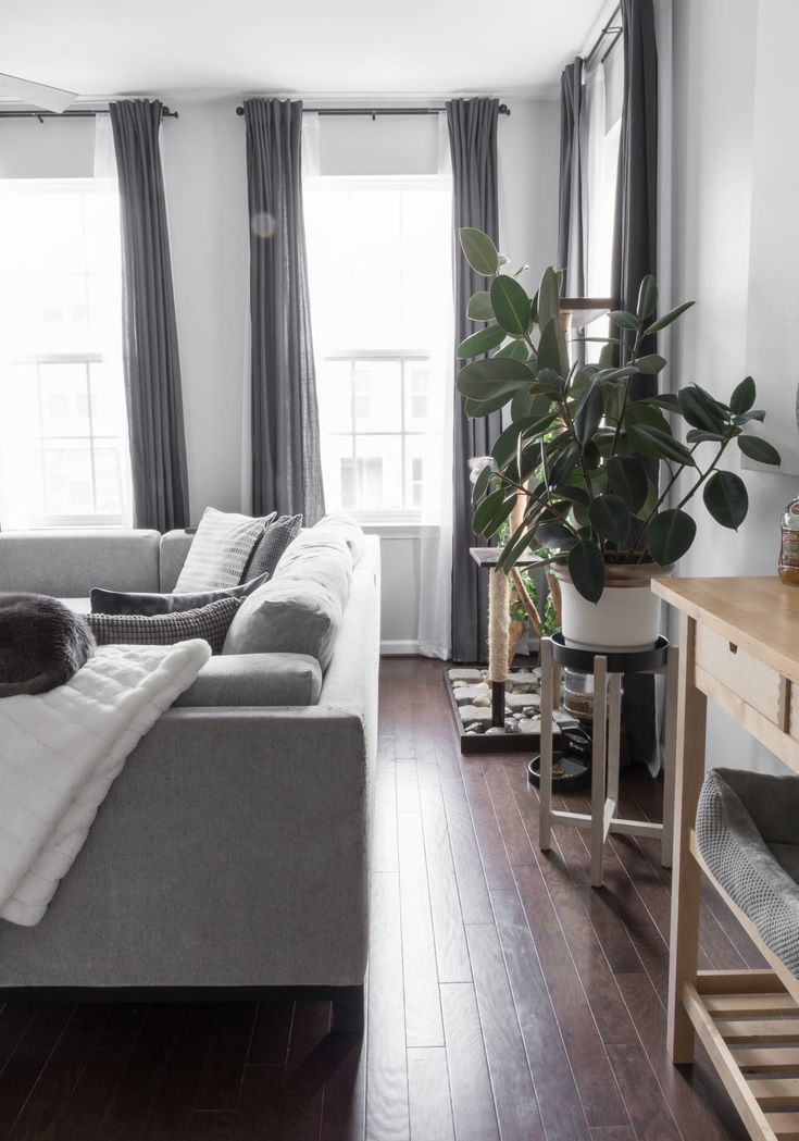 Simple, modern living room. Our modern minimal townhouse for a family of three (and two kitties!). Looking for townhouse decorating ideas? Check out our home tour. #townhomes #townhouse #townhousedecoratingideas #townhouseideas #modernhomedecorlivingroom