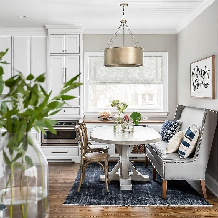 A Brass Drum Light Pendant Hangs From A White Beadboard Ceiling Over A Light Gray Wood Trestle Din Transitional Dining Room Dining Room Small Dining Room Combo