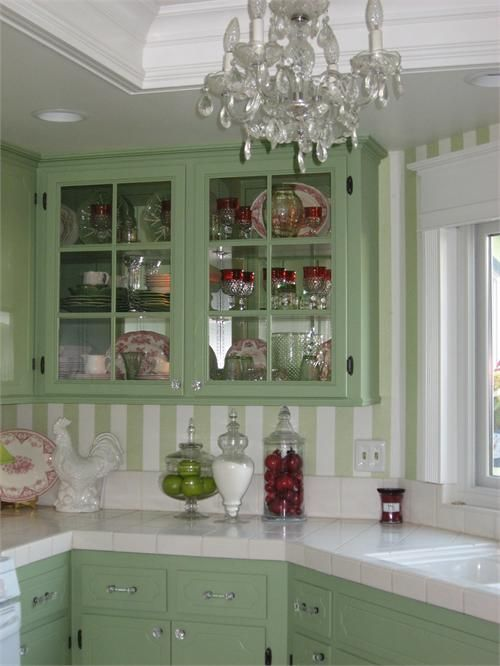 chandelier in kitchen for a tiny cottage...sea foam green cupboards