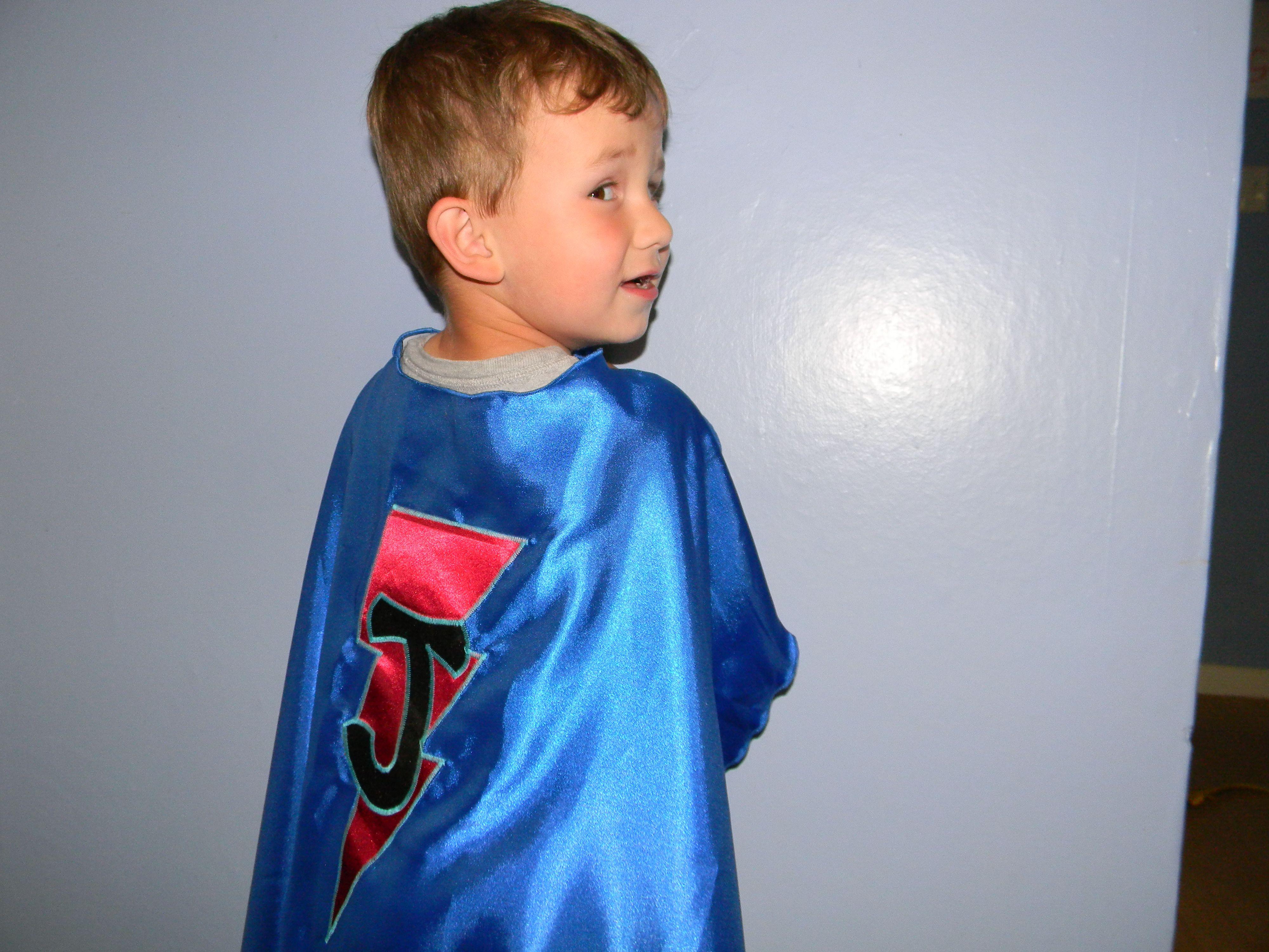Josh modeling his new super hero cape.