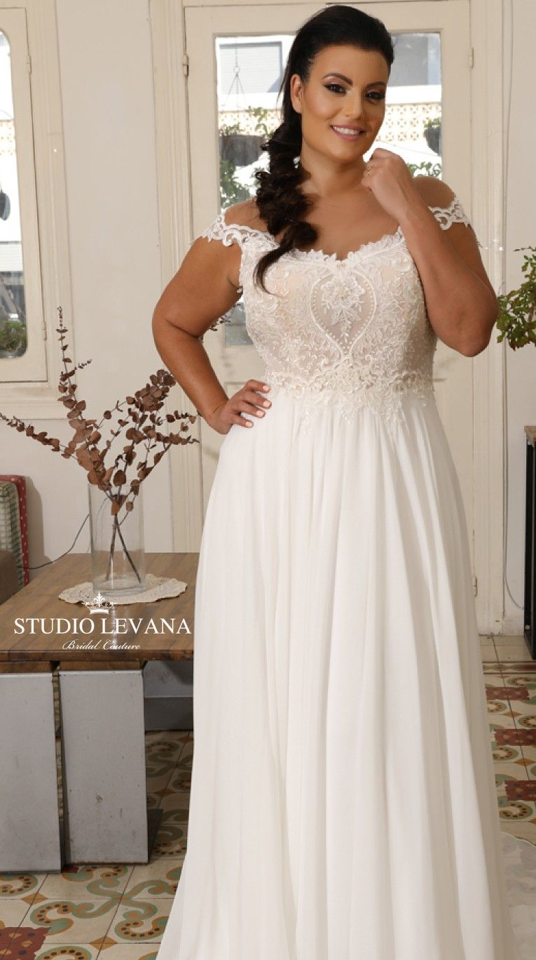 1ae6c987d8 Plus size bohemian wedding gown with unique lace and off shoulder sleeves.  Valentina. Studio Levana